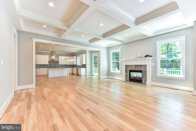Family Room with Coffered Ceilings and Fireplace - 304 NIBLICK DR SE, VIENNA