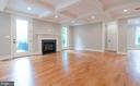 Family Room with Hardwood Floors & Fireplace - 304 NIBLICK DR SE, VIENNA