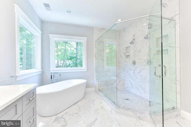 Sumptuous Master Bath with Tub and Shower - 304 NIBLICK DR SE, VIENNA