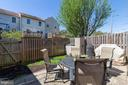 Having a fenced in yard with patio and grass...yea - 13677 BARREN SPRINGS CT, CENTREVILLE