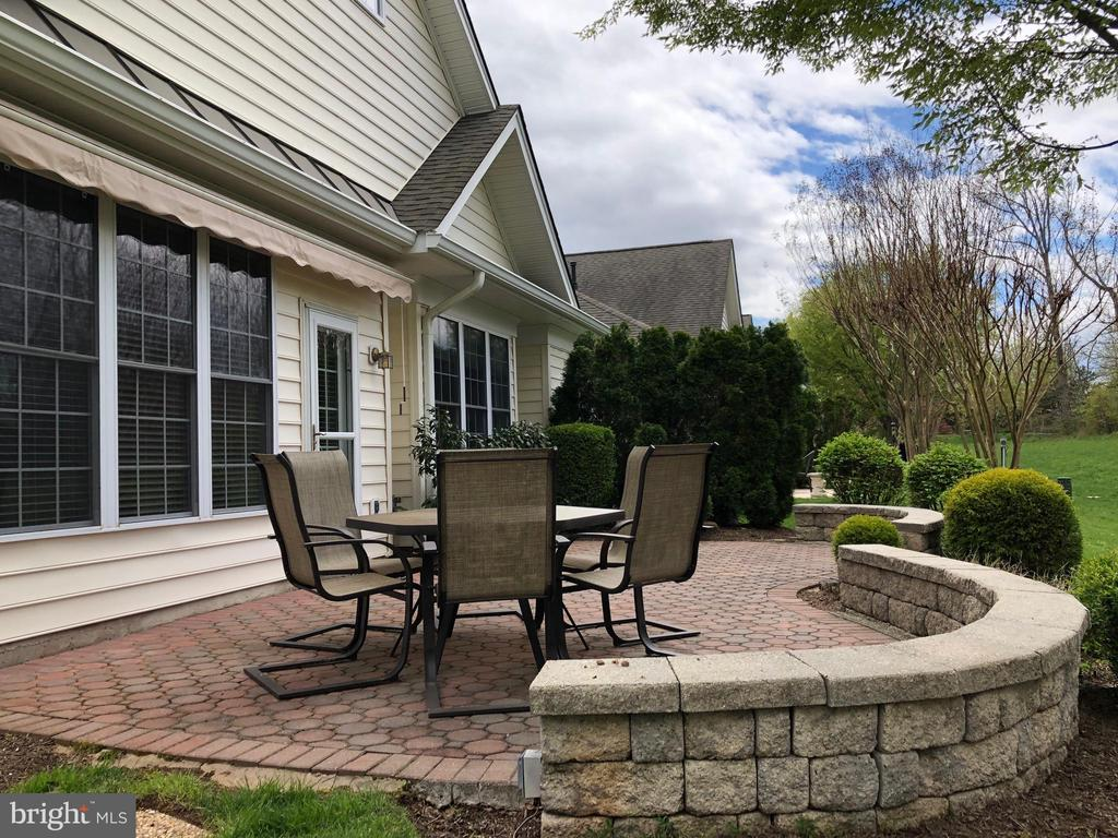 Patio has sitting walls. - 5242 ARMOUR CT, HAYMARKET