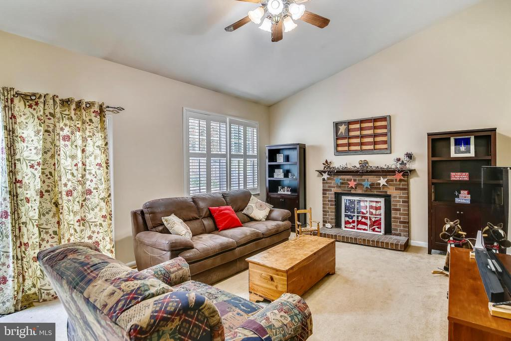 Brick fireplace in family room - 48 SAVANNAH CT, STAFFORD