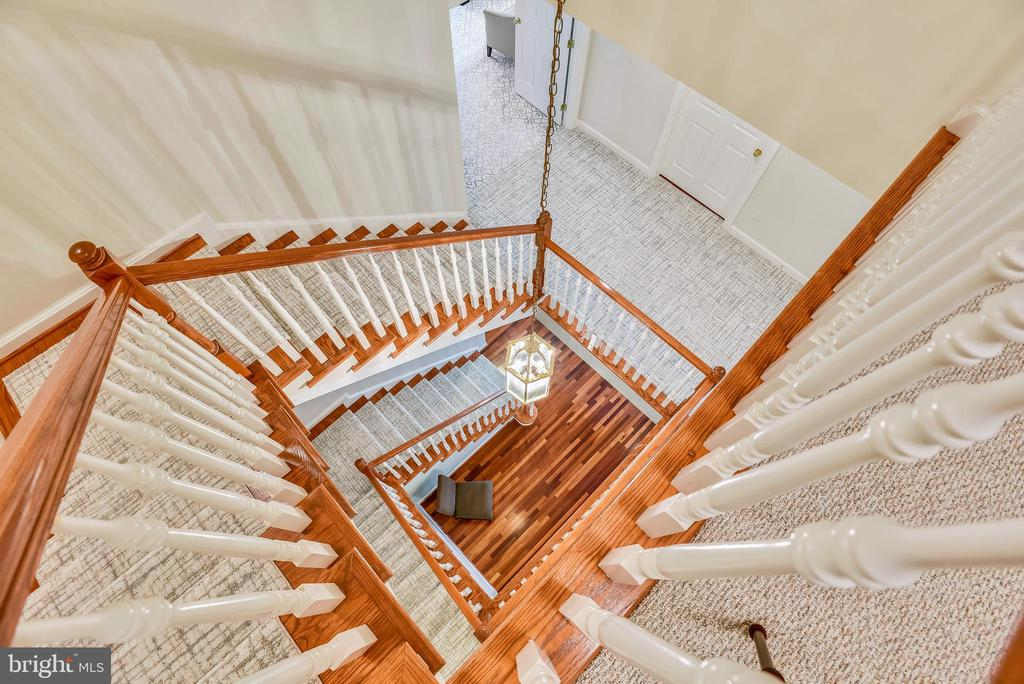 Staircase view from upper level. - 18290 BUCCANEER TER, LEESBURG