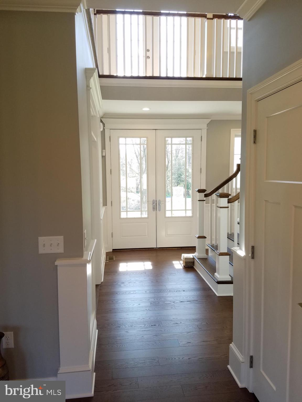 View from great room into 2-story foyer