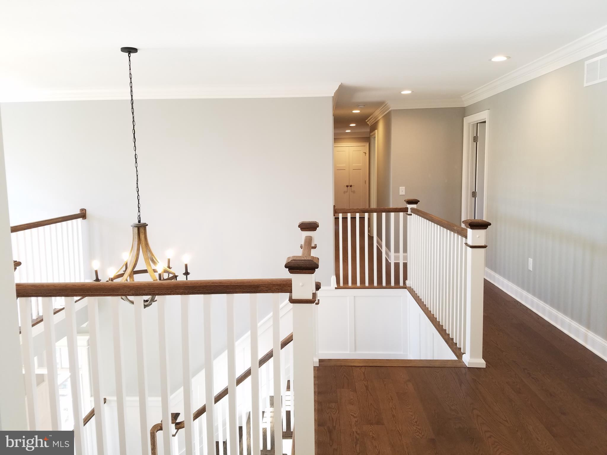 Open staircase from foyer to second floor.