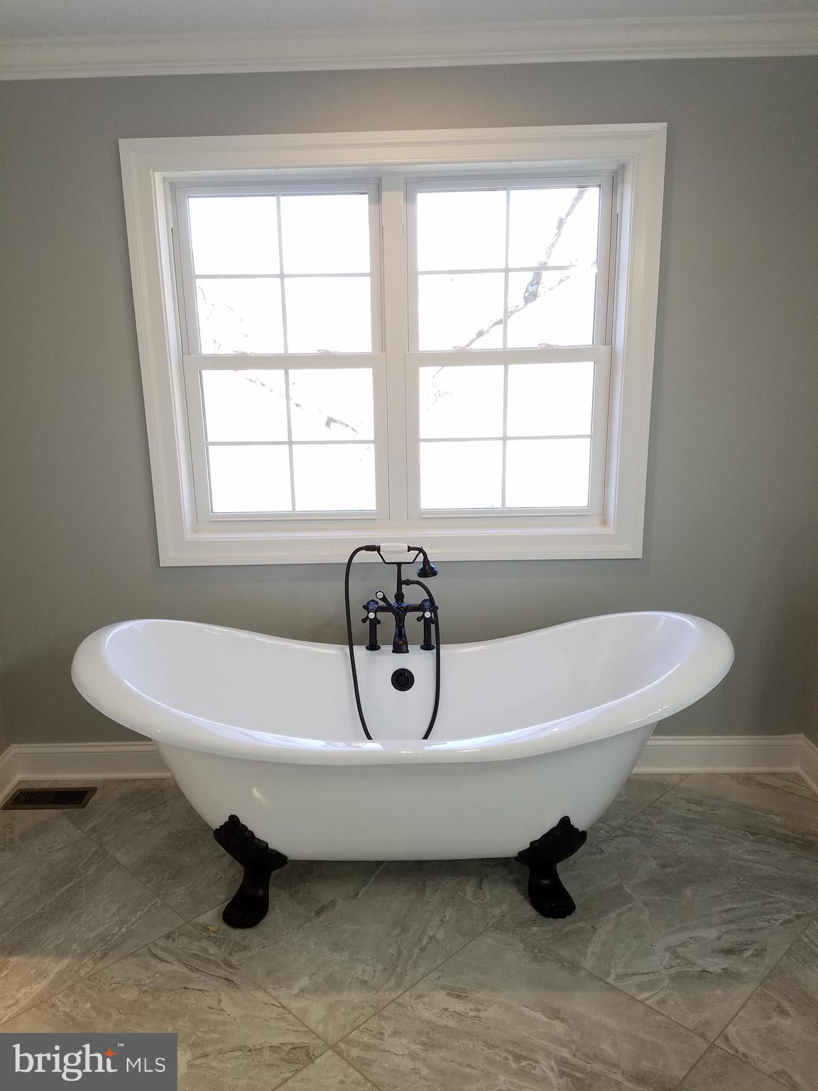 Claw foot soaking tub w/ ORB faucet.