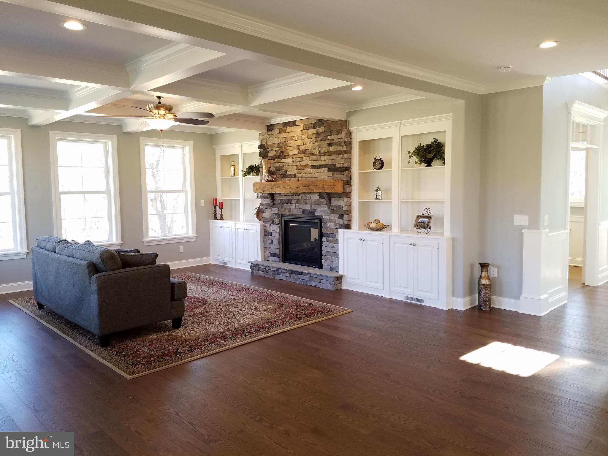Two way fireplace and built in cabinets/shelves