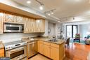 Kitchen has Upgraded S/S Appliances and Storage. - 616 E ST NW #656, WASHINGTON