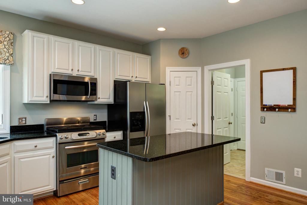 Kitchen, showing Pantry door and Laundry Room - 606 DISKIN PL SW, LEESBURG