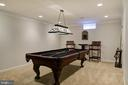 To the right of pool table is door to workshop - 606 DISKIN PL SW, LEESBURG