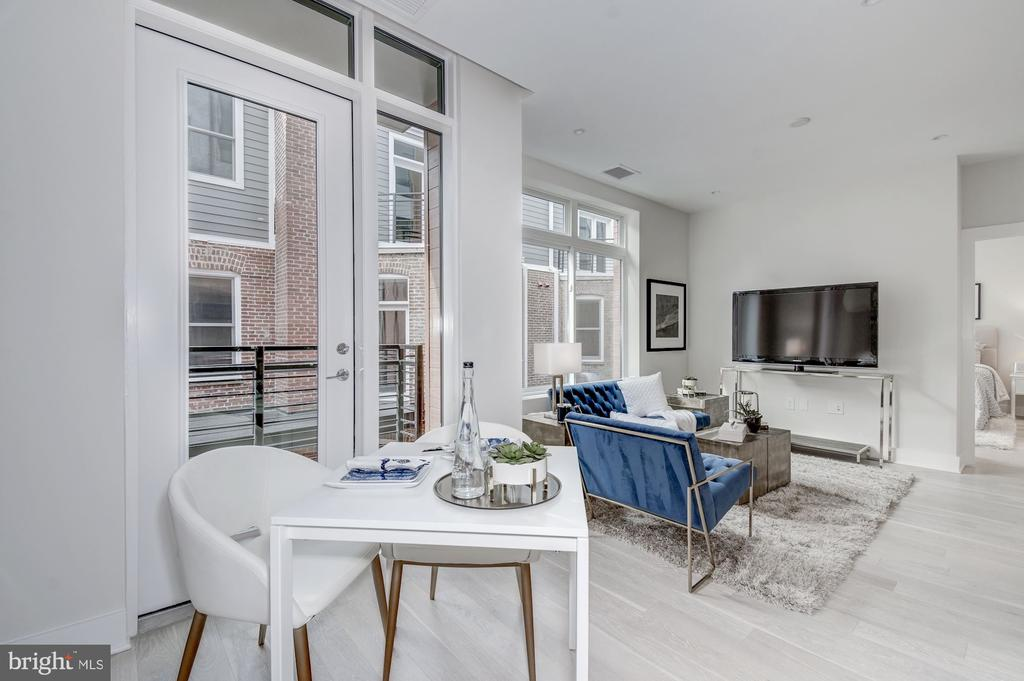 Living area with floor-to-ceiling glass - 1745 N ST NW #406, WASHINGTON