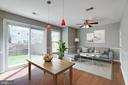 Kitchen Family Room Combination Opens to Patio - 8021 EDINBURGH DR, SPRINGFIELD
