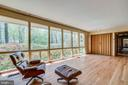 Wall of windows opens to spacious living room - 8522 & 8520 FOREST ST, ANNANDALE