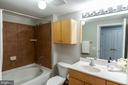 Bathrooms Feature Soaking Tubs and Ample Storage. - 616 E ST NW #656, WASHINGTON