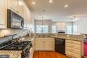 SPACIOUS  GOURMET  KITCHEN - 25657 TREMAINE TER, CHANTILLY