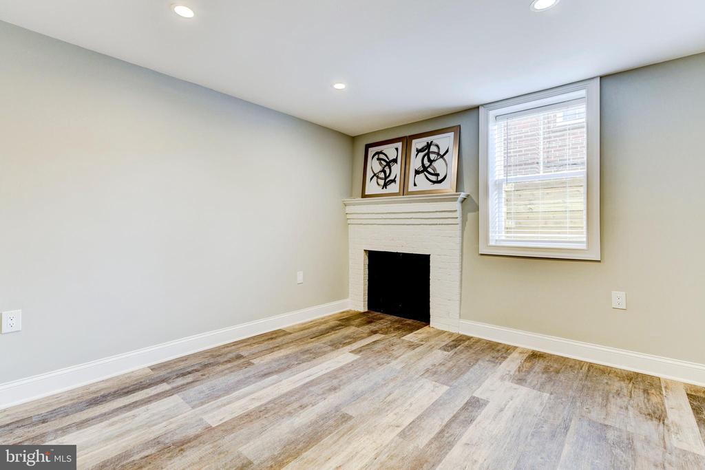 basement bedroom with fireplace & walk-in closet - 4419 19TH PL NE, WASHINGTON