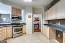 kitchen w/ stainless appliances - 19355 CYPRESS RIDGE TER #120, LEESBURG