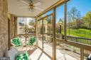 gorgeous terrace overlooking grassy lawn and trees - 19355 CYPRESS RIDGE TER #120, LEESBURG