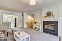Cozy family room with gas logs - 1577 LEEDS CASTLE DR #101, VIENNA