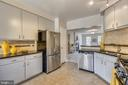 Beautifully updated kitchen! - 1577 LEEDS CASTLE DR #101, VIENNA