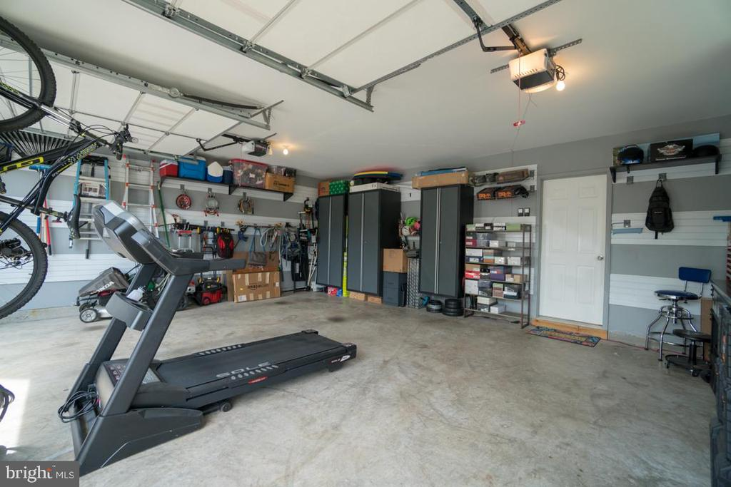 Over-sized Garage with Professional Storage System - 42442 GREAT HERON SQ, BRAMBLETON