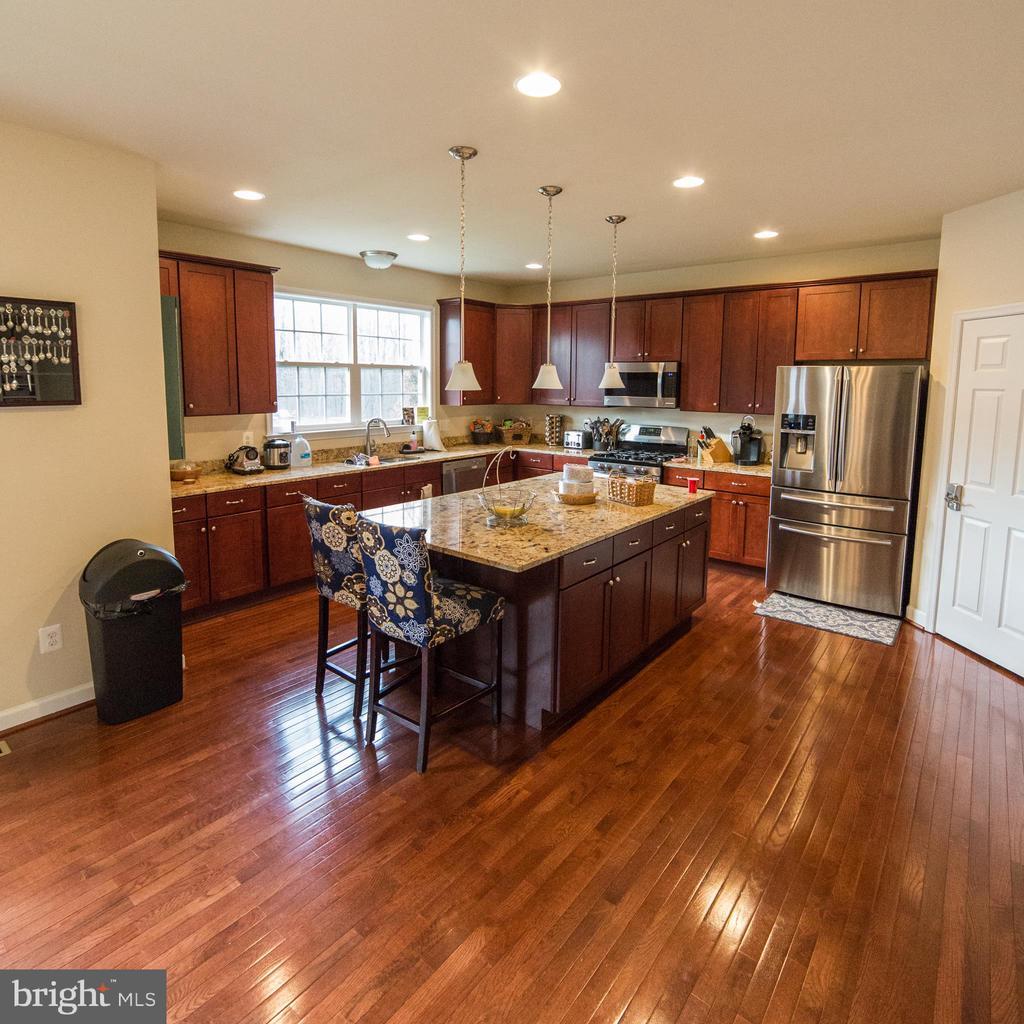 Kitchen with Island and Hardwood Floors - 1030 ALBERT RENNOLDS DR, FREDERICKSBURG