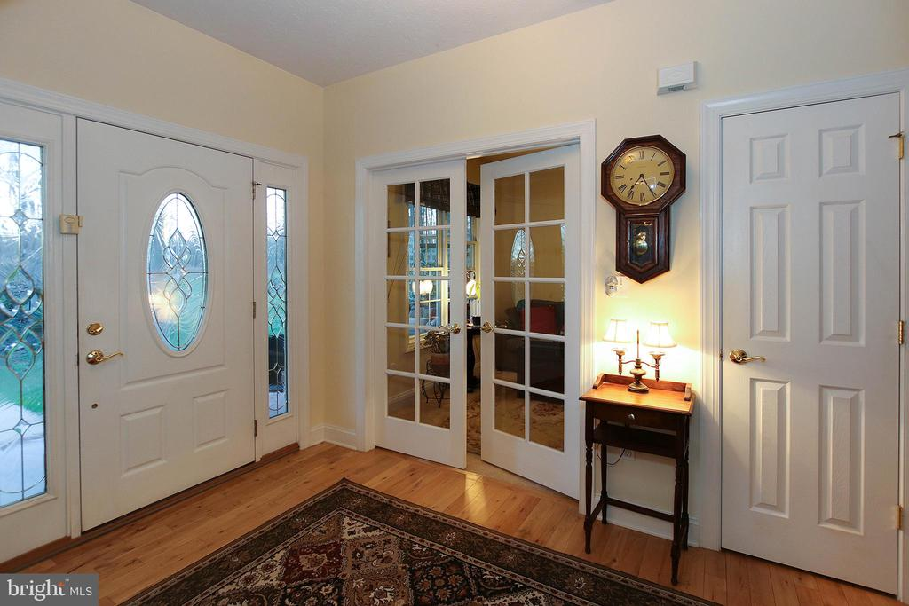 A private study awaits behind these doors - 800 CATTAIL RD, WINCHESTER