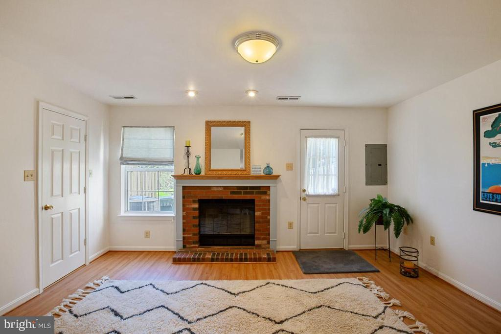 Main level with a wood burning fireplace - 13102 KIDWELL FIELD RD, HERNDON