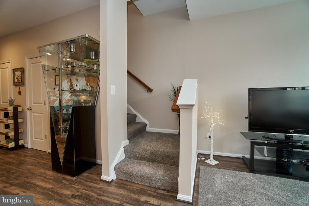 Stairs up to bedroom level - 7953 CRESCENT PARK DR #153, GAINESVILLE