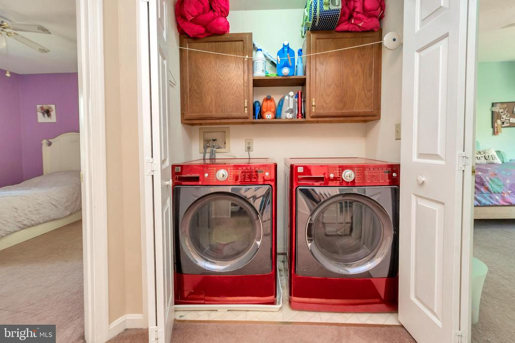 Upstairs laundry with built ins - 2999 LUSITANIA DR, STAFFORD