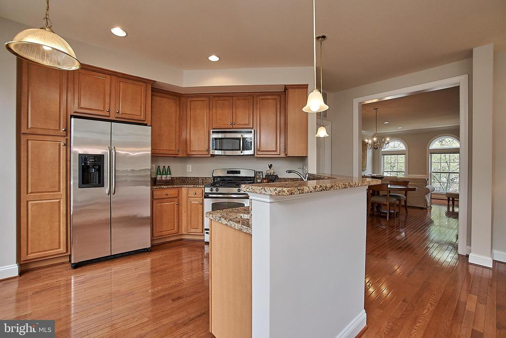 Gourmet kitchen with functional bar/island. - 1220 S GLEBE RD, ARLINGTON