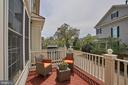 Inviting back deck overlooking the complex green. - 1220 S GLEBE RD, ARLINGTON