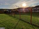 View toward the playground through the fence. - 4152 AGENCY LOOP, TRIANGLE