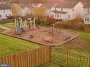 View of playground from deck at dusk. - 4152 AGENCY LOOP, TRIANGLE