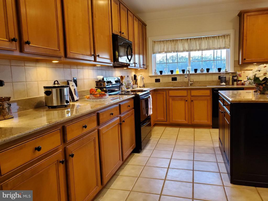 Ample cabinets and drawers in Kitchen and island. - 4152 AGENCY LOOP, TRIANGLE