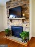 Stone wall hearth and gas fireplace in FR. - 4152 AGENCY LOOP, TRIANGLE
