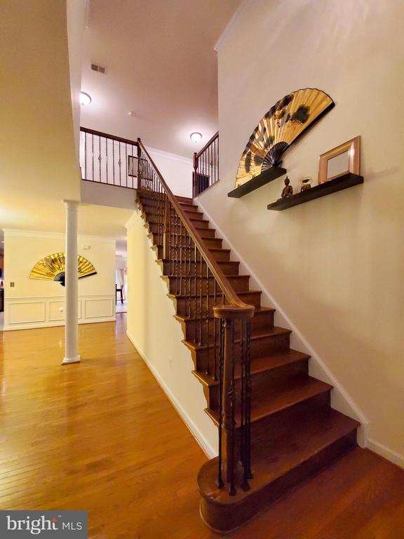 The grand staircase, lined w/wrought iron pickets. - 4152 AGENCY LOOP, TRIANGLE