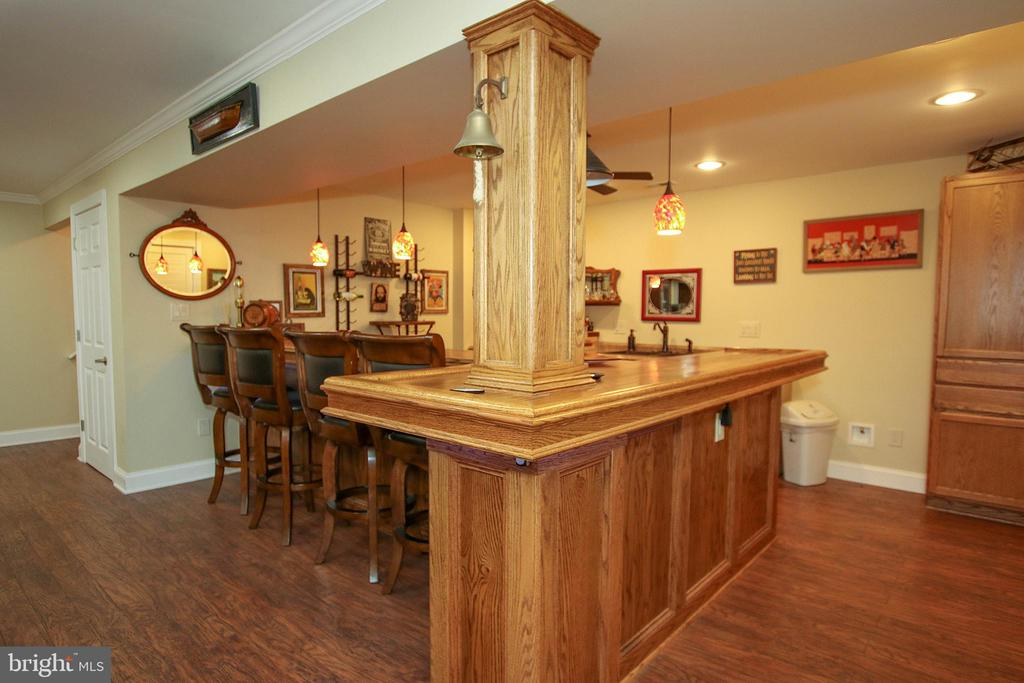 Entertain in style at this HUGE custom oak bar - 800 CATTAIL RD, WINCHESTER