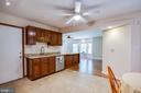 Kitchen, breakfast area & family room view - 8427 BATTLE PARK DR, SPOTSYLVANIA
