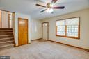 Living room view of upper stairs & front entry - 8427 BATTLE PARK DR, SPOTSYLVANIA