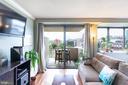 Living room open to balcony - 4141 HENDERSON RD #815, ARLINGTON