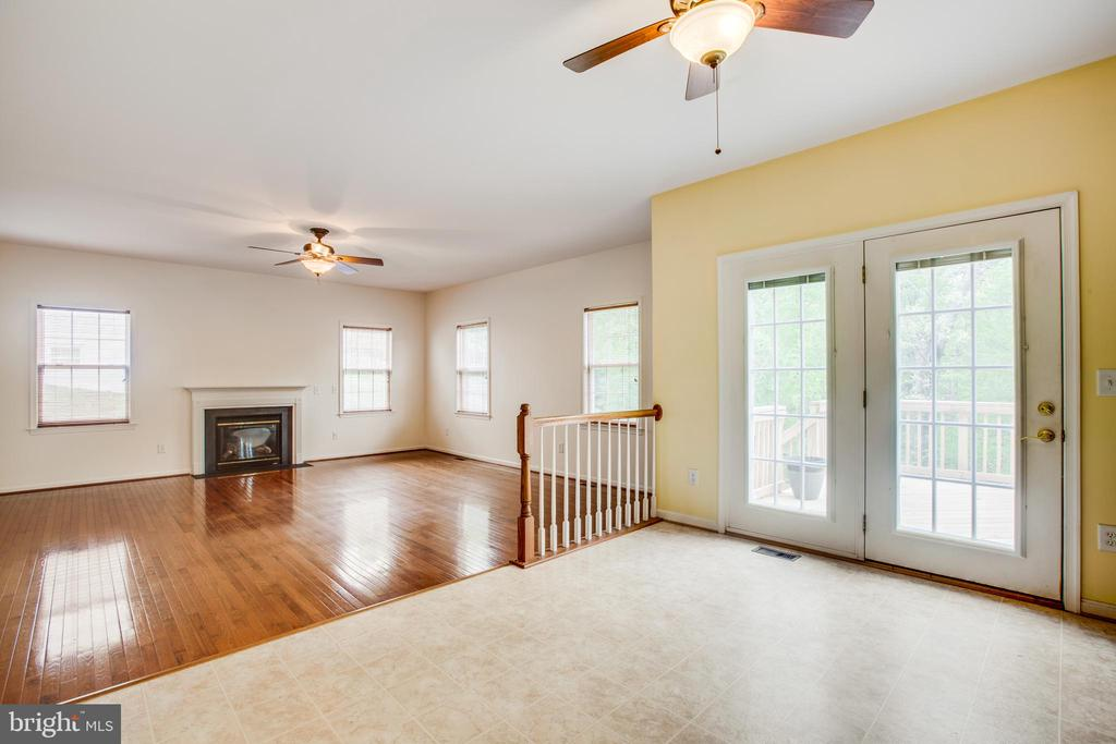 Kitchen w/table space and family room w/fireplace - 1106 GREAT OAKS LN, FREDERICKSBURG