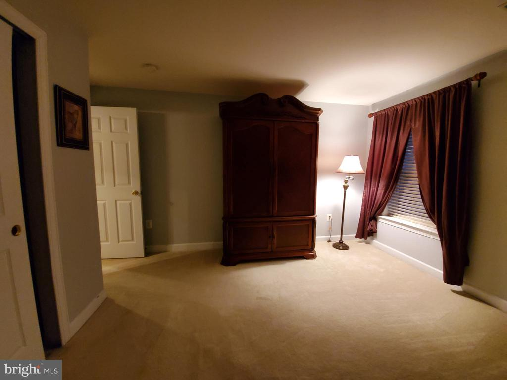 5th Bedroom in the basement.  Armoire conveys. - 4152 AGENCY LOOP, TRIANGLE