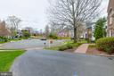 Asphalt driveway. Brick walkway. - 2405 SAGARMAL CT, DUNN LORING