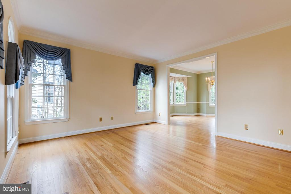 This floor is prior to sanding and refinishing. - 2405 SAGARMAL CT, DUNN LORING