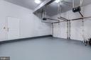 Freshly painted garage. Door to side yard. - 2405 SAGARMAL CT, DUNN LORING