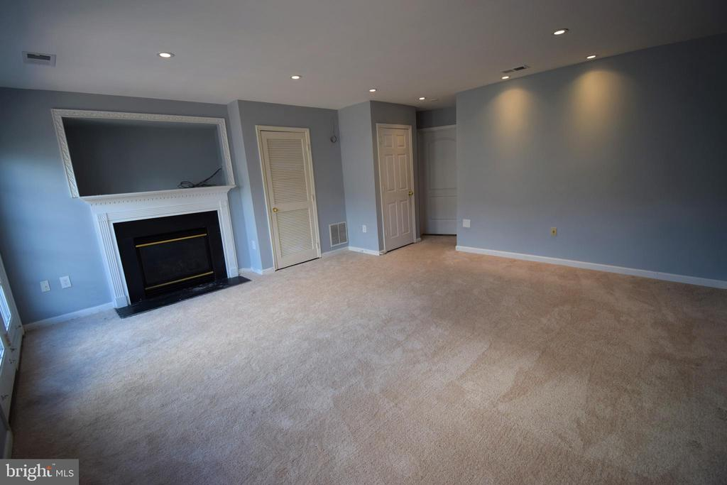 Lower level: Family room w/fireplace and walkout - 22953 WHITEHALL TER, STERLING