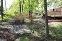 Back yard, from back left corner - 9005 CHERRYTREE DR, ALEXANDRIA