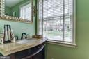 Renovated powder room - 6006 COREWOOD LN, BETHESDA