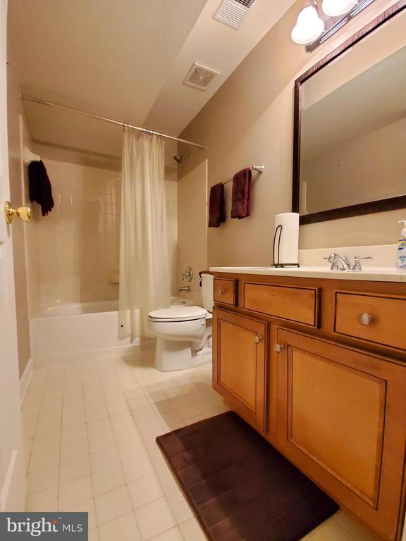 Full basement bath with tile floor. - 4152 AGENCY LOOP, TRIANGLE